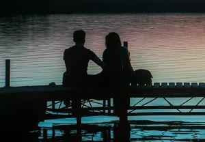 The online Australian Will Kit couple sitting on pier